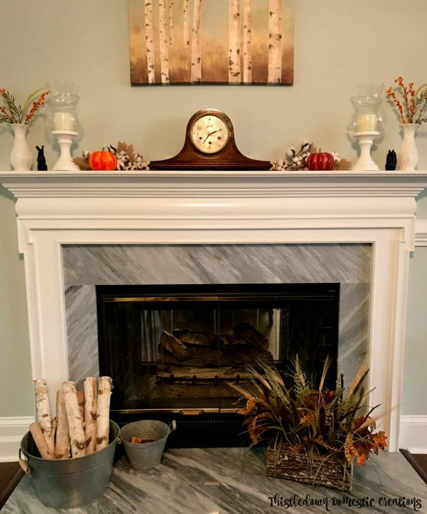 A decorated fall mantel.
