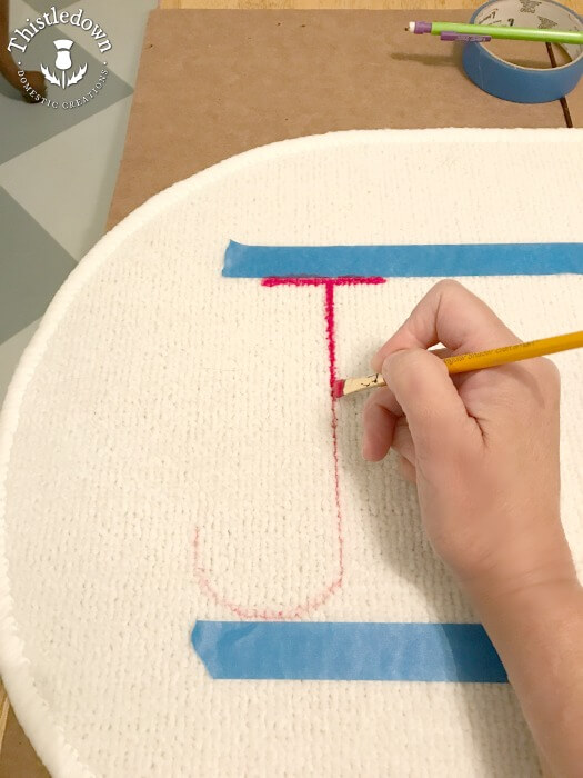 painting the festive mat